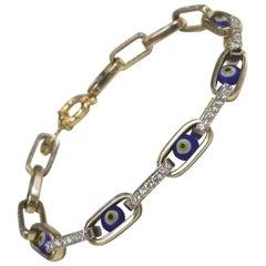 "14 Karat Yellow Gold Diamond and ""Evil Eye"" Bracelet"