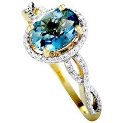 14 Karat Yellow Gold Diamond and London Topaz Oval Ring