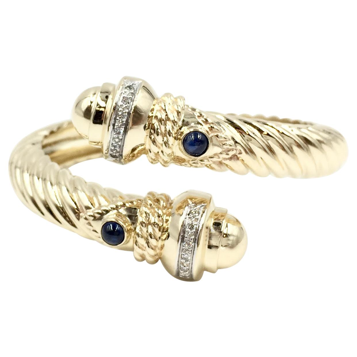 14 Karat Yellow Gold Diamond and Sapphire Bypass Cable Cuff Bracelet