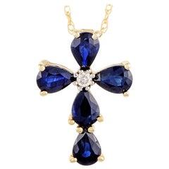 14 Karat Yellow Gold Diamond and Sapphire Cross Pendant Necklace