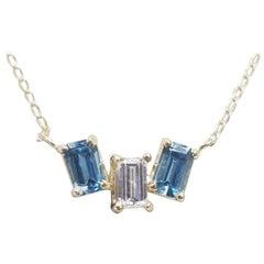 14 Karat Yellow Gold Diamond Baguette and Blue Topaz Pendant