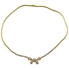 14 Karat Yellow Gold Diamond Bow Necklace
