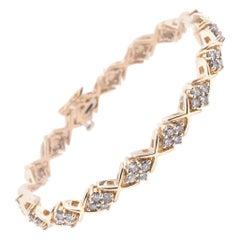14 Karat Yellow Gold Diamond Cluster X Tennis Bracelet