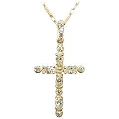 14 Karat Yellow Gold Diamond Cross Total Weight .86pts
