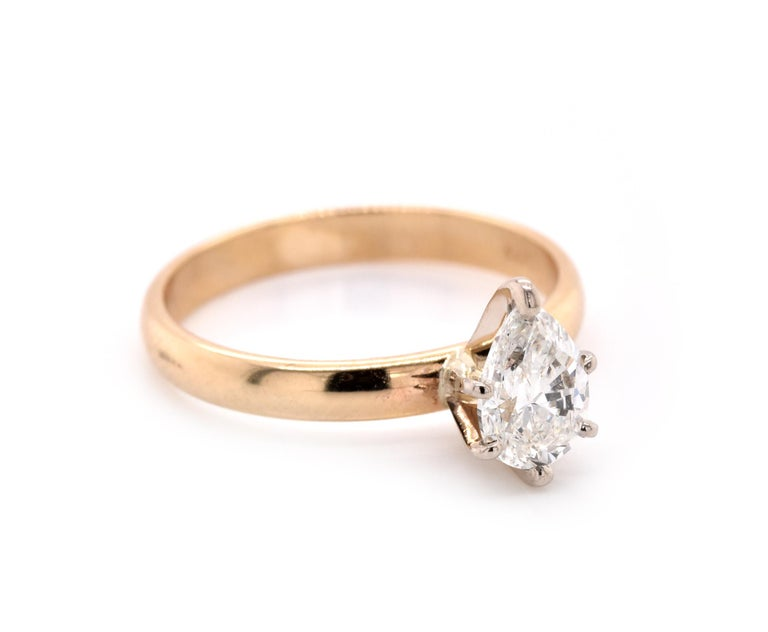 Material: 14k yellow gold Center Diamond: 1 pear cut = .71ct Color: H Clarity: VS2 Ring Size: 6 (please allow up to 2 additional business days for sizing requests) Dimensions: Ring measures 2.7mm in diameter  Weight: 2.38 grams
