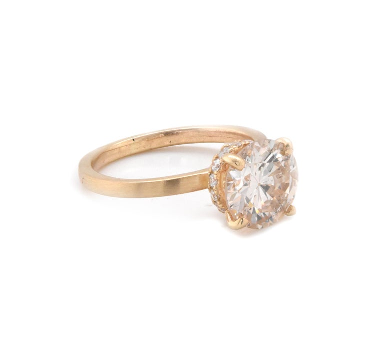 Material: 14K yellow gold Center Diamond: 1 round brilliant cut = 2.20ct Color: L Clarity: I1 Diamond: 12 round cut = .25cttw Color: G Clarity: VS Ring Size: 5.5 (please allow up to 2 additional business days for sizing requests) Dimensions: ring