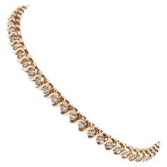 14 Karat Yellow Gold Diamond S Link Tennis Bracelet