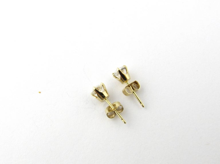 Round Cut 14 Karat Yellow Gold Diamond Stud Earrings .60 Carat For Sale