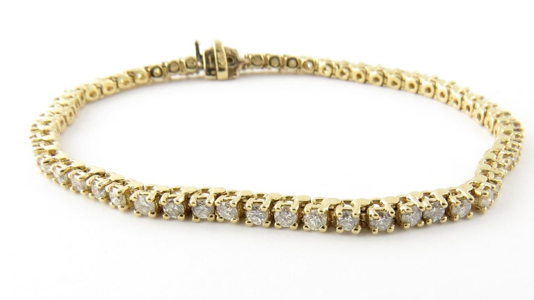 Vintage 14 Karat Yellow Gold Diamond Tennis Bracelet 1.71 cts. twt.-  This spectacular tennis bracelet features 57 round brilliant cut diamonds set in classic 14K yellow gold. Safety closure.  Approximate total diamond weight: 1.71 cts.  Diamond