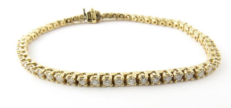14 Karat Yellow Gold Diamond Tennis Bracelet 1.71 Carat For Sale
