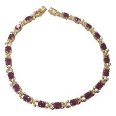 "14 Karat Yellow Gold Ruby ""Tennis"" Bracelet, Containing 20 Oval Cut Rubbies"