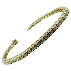 14 Karat Yellow Gold and Diamond Tennis Bracelet