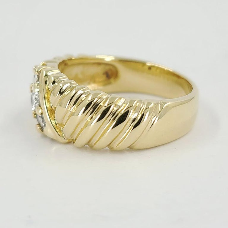 14 Karat Yellow Gold Ring With Rope Design Featuring 3 Round Brilliant Cut Diamonds Totaling 0.12 Carats Of SI Clarity & H Color. Current Finger Size 6.5; Purchase Includes One Sizing Service Up Or Down 2 Sizes. Finished Weight Is 6.5 Grams.