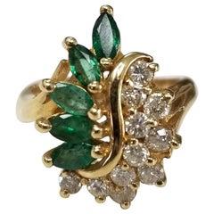 14 Karat Yellow Gold Emerald and Diamond Cluster Ring