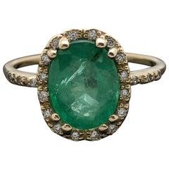 14 Karat Yellow Gold Emerald and Diamonds Ring