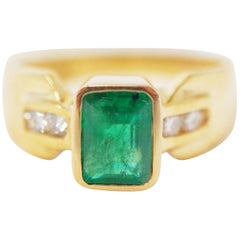 14 Karat Yellow Gold Emerald-Cut Emerald Ring with Diamonds
