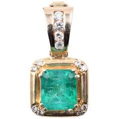 14 Karat Yellow Gold Emerald Diamond Pendant