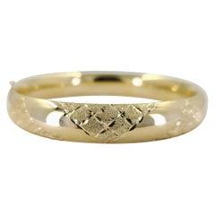 14 Karat Yellow Gold Engraved Hinged Bangle Bracelet