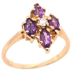 14 Karat Yellow Gold Fashion Amethyst Ring with Center Diamond