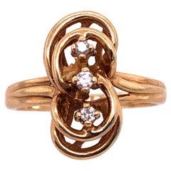 14 Karat Yellow Gold Fashion Ring with Three Round Diamonds