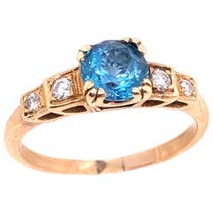 14 Karat Yellow Gold Fashion Round Blue Topaz with Diamond Accents Ring