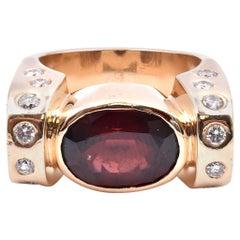 14 Karat Yellow Gold Garnet and Diamond Fashion Ring
