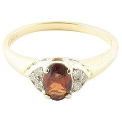 14 Karat Yellow Gold Garnet and Diamond Ring