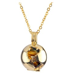 14 Karat Yellow Gold Globe and Round Tiger's Eye Locket Pendant Necklace
