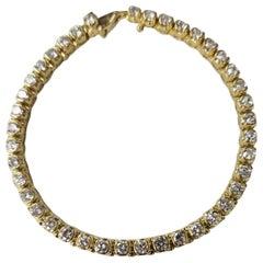 14 Karat Yellow Gold Half Bezel Set Diamond Tennis Bracelet Weighing 5.00 Carat