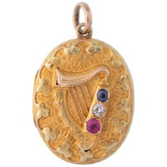 14 Karat Yellow Gold Hand Engraved Ruby Sapphire Diamond Harp Locket