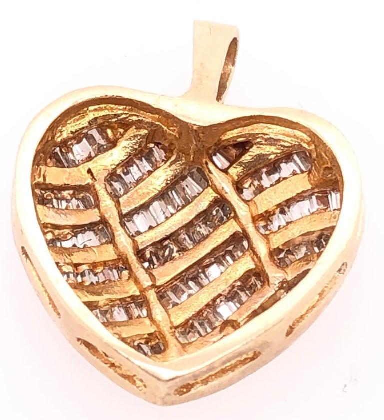 14 Karat Yellow Gold Heart Charm/Pendant with Diamonds. 3.3 grams total weight.