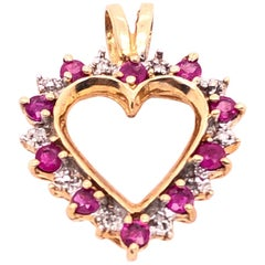 14 Karat Yellow Gold Heart Diamond and Amethyst Pendant