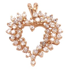 14 Karat Yellow Gold Heart Pendant Encrusted with Diamonds