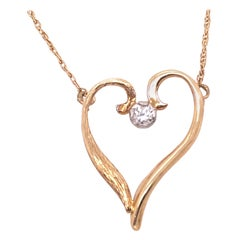 14 Karat Yellow Gold Heart Soldered Pendant with Center Diamond Necklace