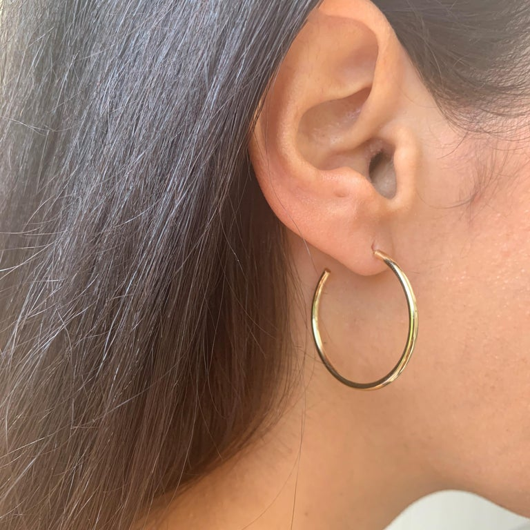 These Elegant and Stylish 14K Yellow Gold Hoop Earrings will add that perfect Glam to your look! Earring Measurments are 2 X 30 MM. Made in Italy. 1.5