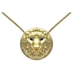 14 Karat Yellow Gold Lion Pendant Necklace with Sapphire Eyes