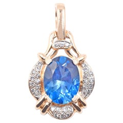 14 Karat Yellow Gold London Blue Topaz and Diamond Pendant