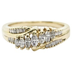 14 Karat Yellow Gold Marquise and Baguette Wedding Ring