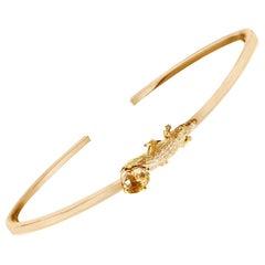 14 Karat Yellow Gold Mesopotamian Bracelet with Natural Oval Yellow Sapphire