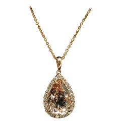 14 Karat Yellow Gold Morganite and Diamond Pendant