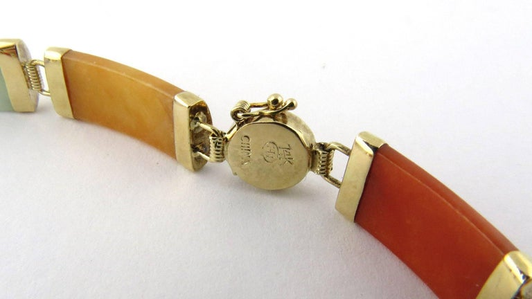 Vintage 14K Yellow Gold Multi Color Jade Bracelet   This bracelet has a beautiful variety of colors - green, white, orange, red and purple jade   8