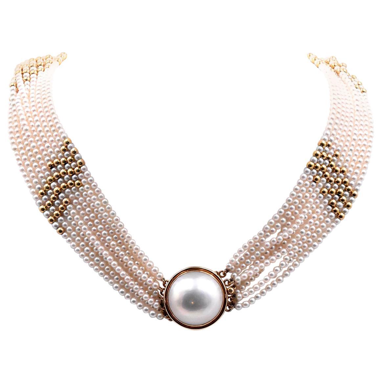 14 Karat Yellow Gold Multi Strand Pearl Necklace