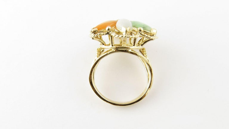 Vintage 14 Karat Yellow Gold Multicolored Jade Ring Size 6.5. This lovely ring features six marquis multicolored jade stones (10 mm x 5 mm) set in a stunning 14K yellow gold floral design.  Top of ring measures 24 mm. Shank measures 3 mm. Ring Size: