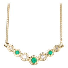 14 Karat Yellow Gold Neck-Piece with Emerald and Diamond