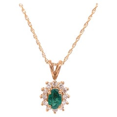14 Karat Yellow Gold Necklace with Oval Emerald and Diamonds Pendant