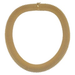 14 Karat Yellow Gold Omega Style Necklace with a Mesh Design