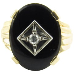 14 Karat Yellow Gold Onyx and Diamond Ring