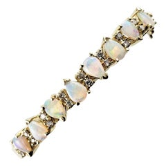14 Karat Yellow Gold Opal and Diamond Bangle Bracelet