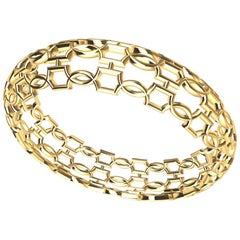 14 Karat Yellow Gold Open Circles Bangle