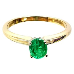 14 Karat Yellow Gold Oval Cut Emerald Solitaire Ring